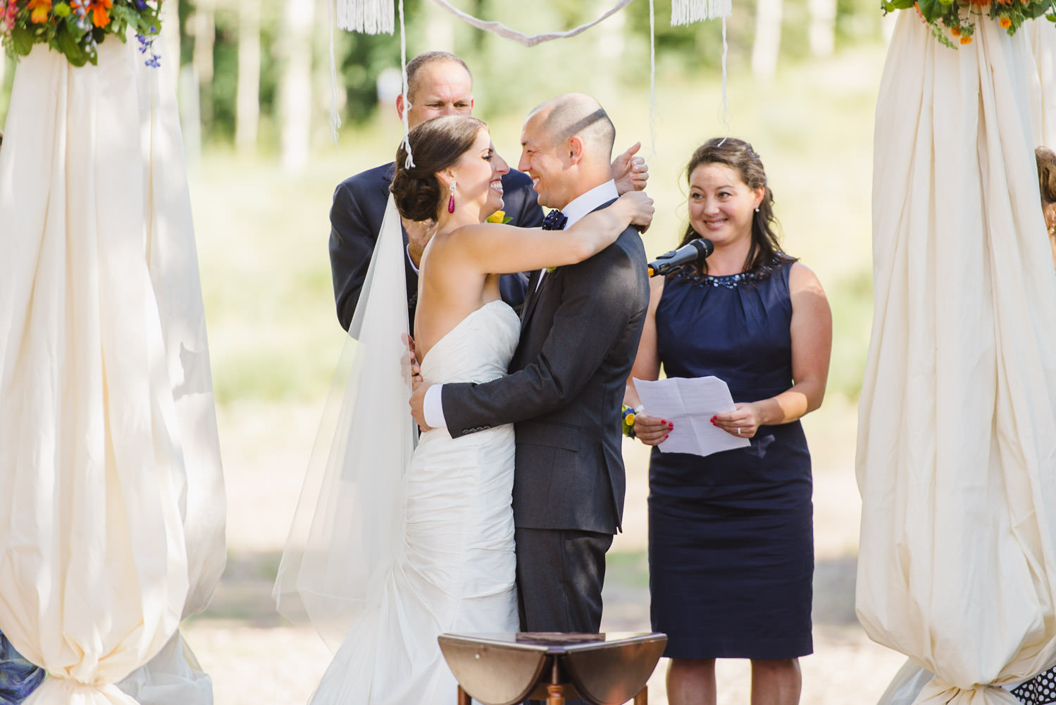 Red Pine Lodge bride and groom first kiss wedding photo