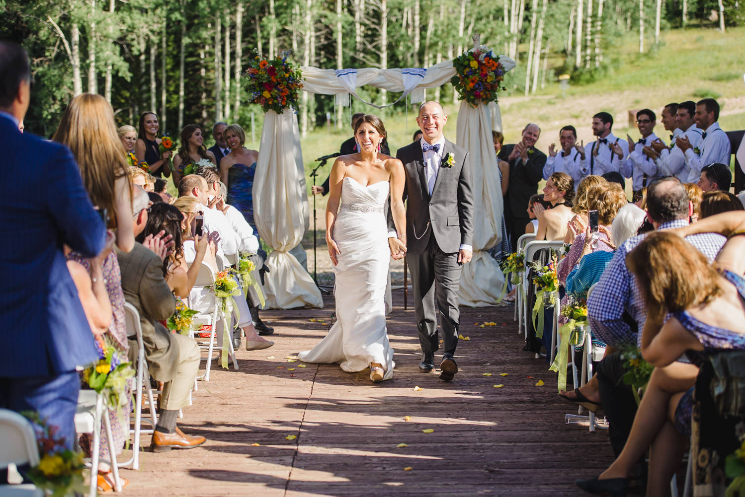 Red Pine Lodge bride and groom walking down aisle photo