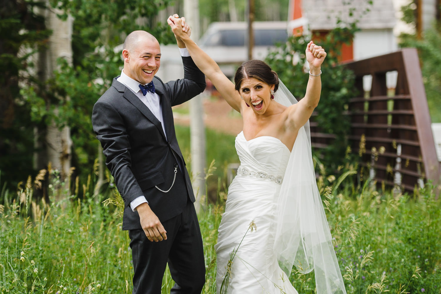 Red Pine Lodge bride and groom celebrating wedding photo