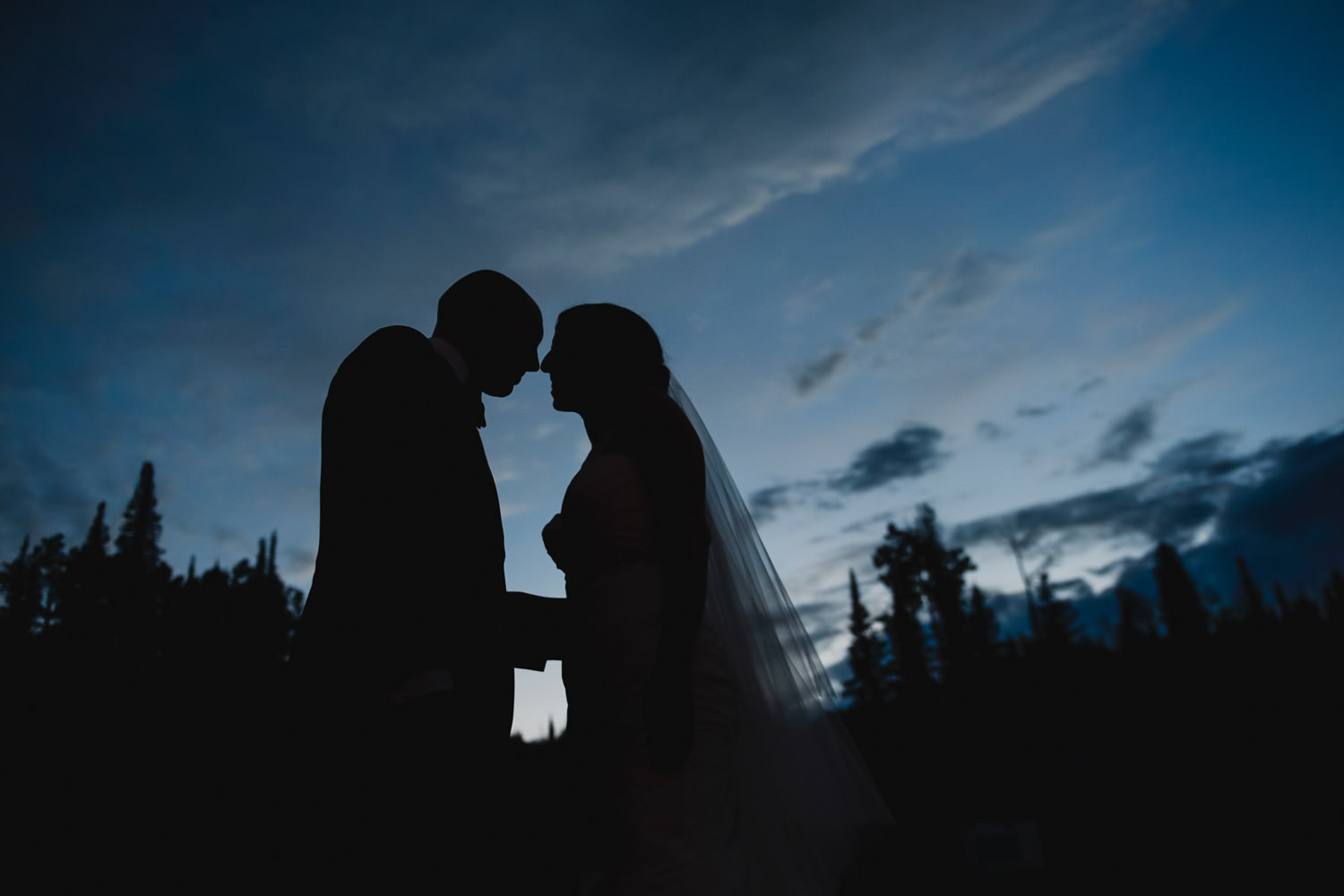 Red Pine Lodge bride and groom at dusk wedding photo