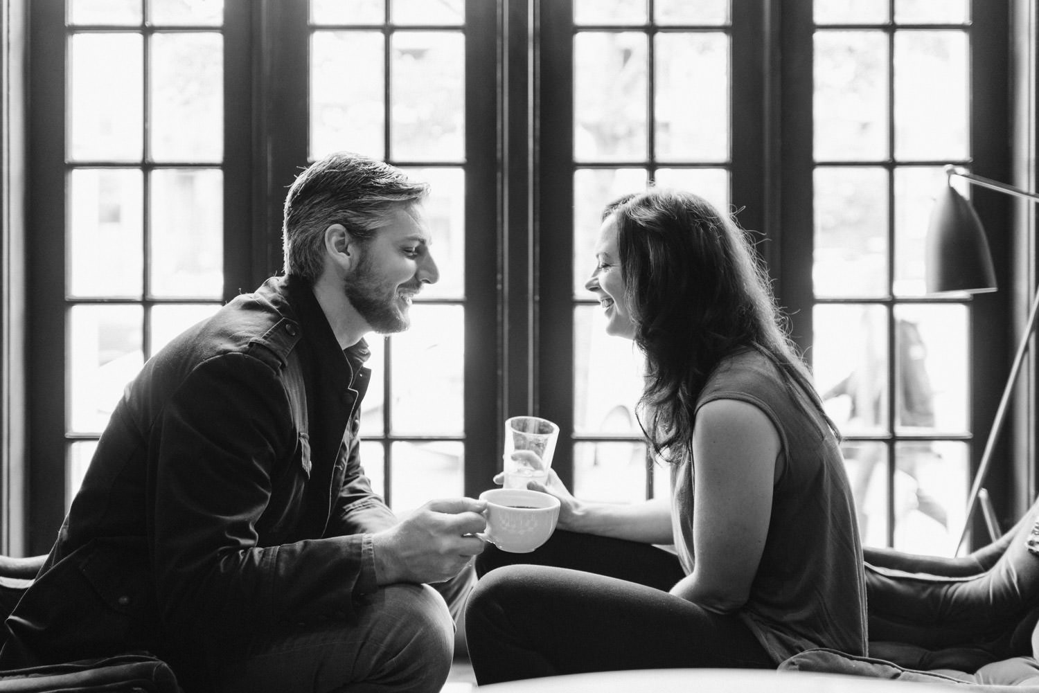 Downtown SLC Engagement couple laughing over coffee photo