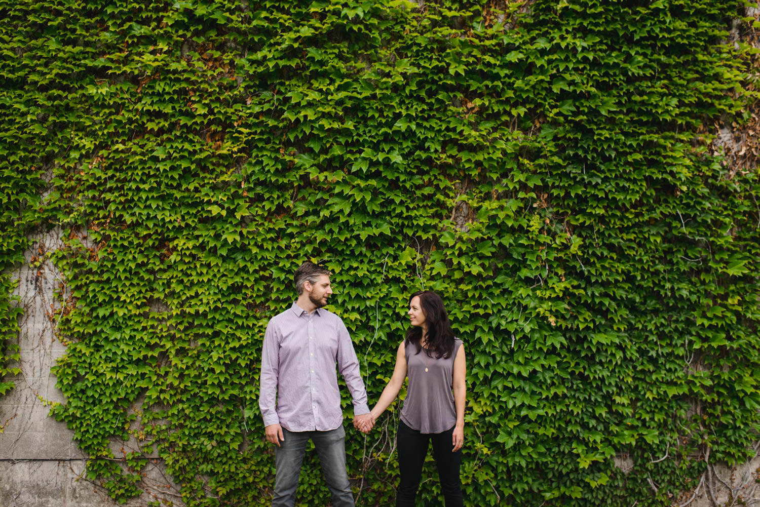 Downtown SLC Engagement couple holding hands photo