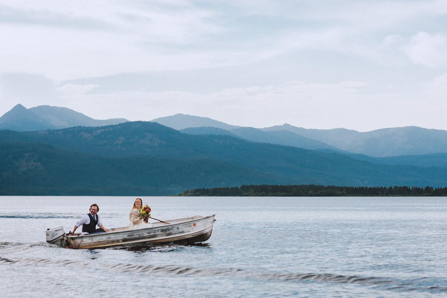 West Yellowstone Wedding bride and groom boating on Hebgen Lake photo