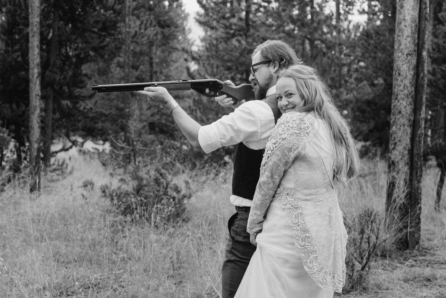 West Yellowstone Wedding bride and groom shooting shotguns photo