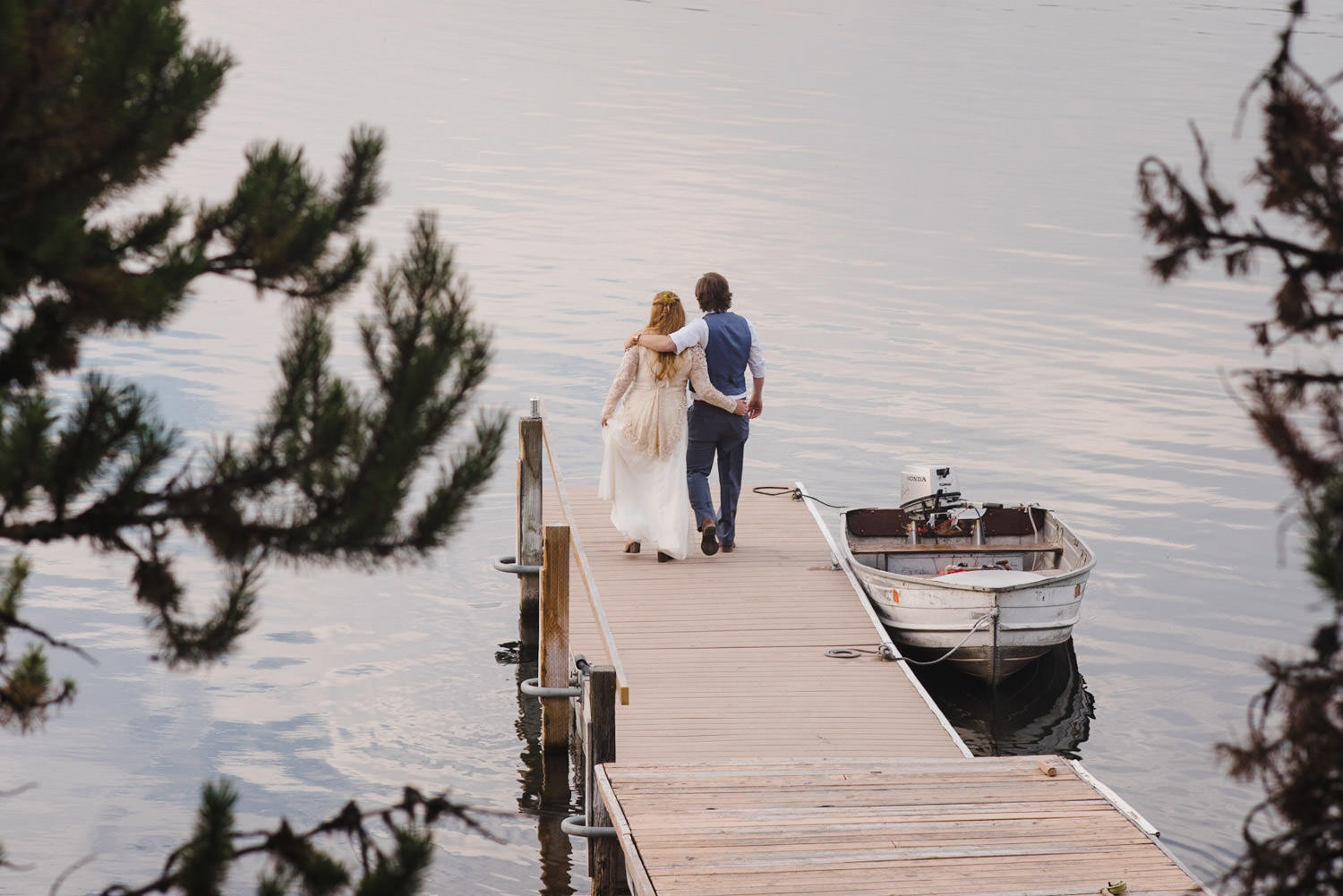 West Yellowstone Wedding bride and groom walking down the dock photo