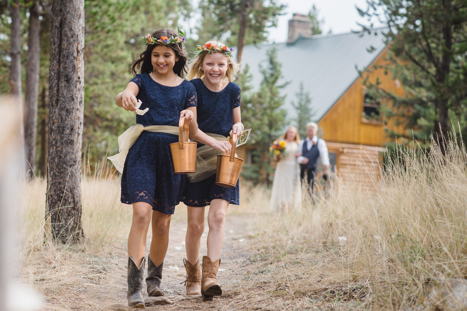 West Yellowstone Wedding flower girls walking down aisle photo
