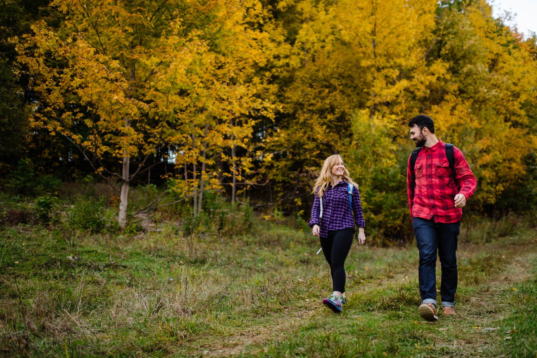 Burlington, Vermont Autumn Engagement couple walking and smiling photo