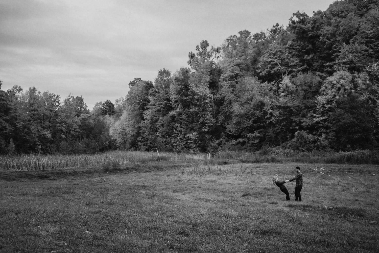 Burlington, Vermont Autumn Engagement couple dancing in a meadow photo