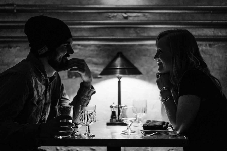 Burlington, Vermont Autumn Engagement couple smiling over drinks photo