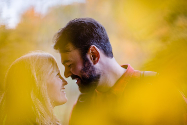 Burlington, Vermont Autumn Engagement couple smiling at each other photo