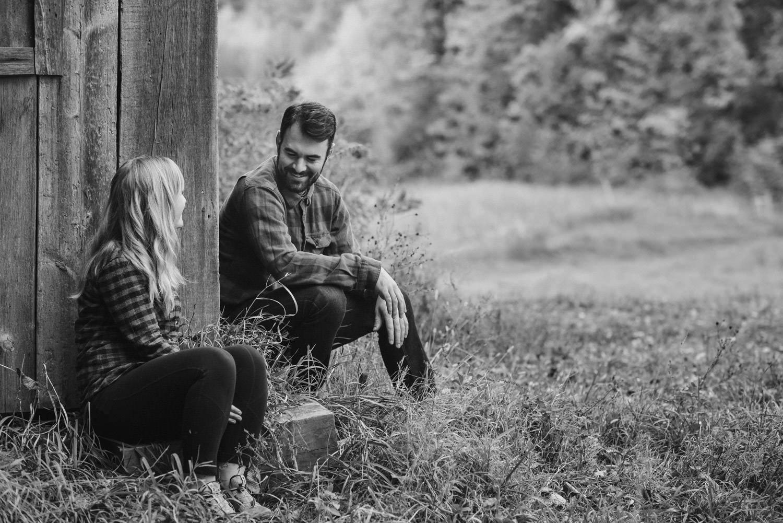 Burlington, Vermont Autumn Engagement man smiling at his fiancée photo