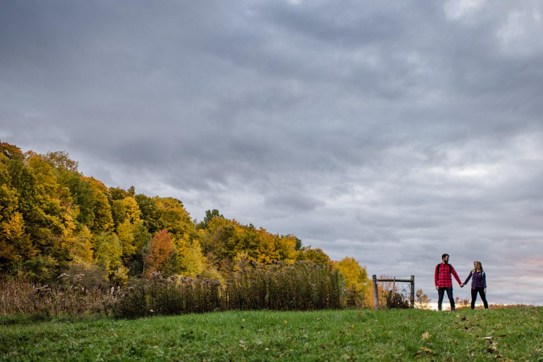 Burlington, Vermont Autumn Engagement couple holding hands photo