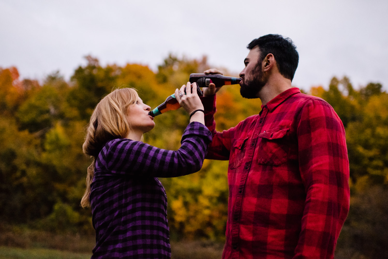 Burlington, Vermont Autumn Engagement couple drinking beer together photo