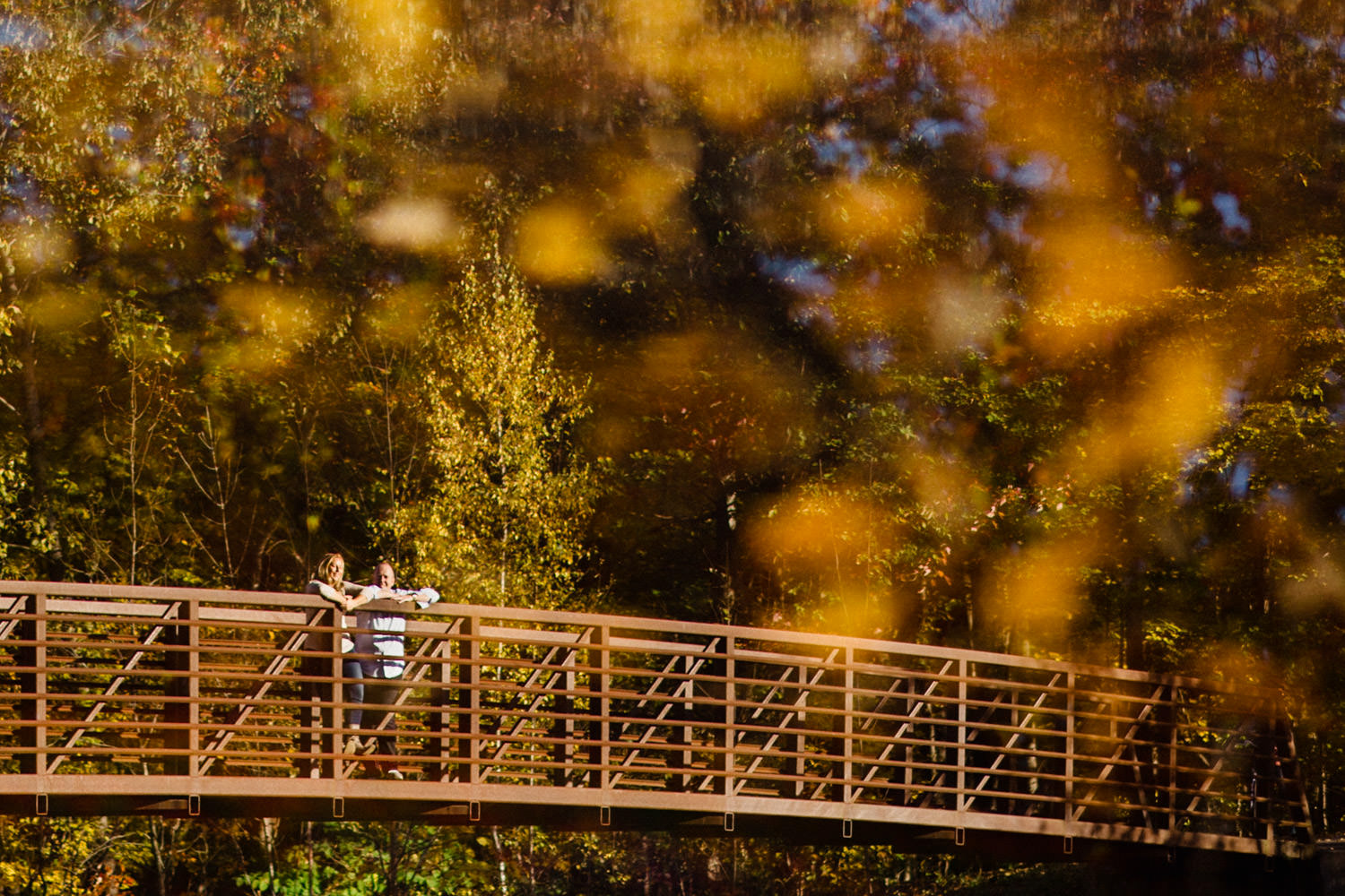 Vermont Fall Colors Engagement couple on a bridge photo