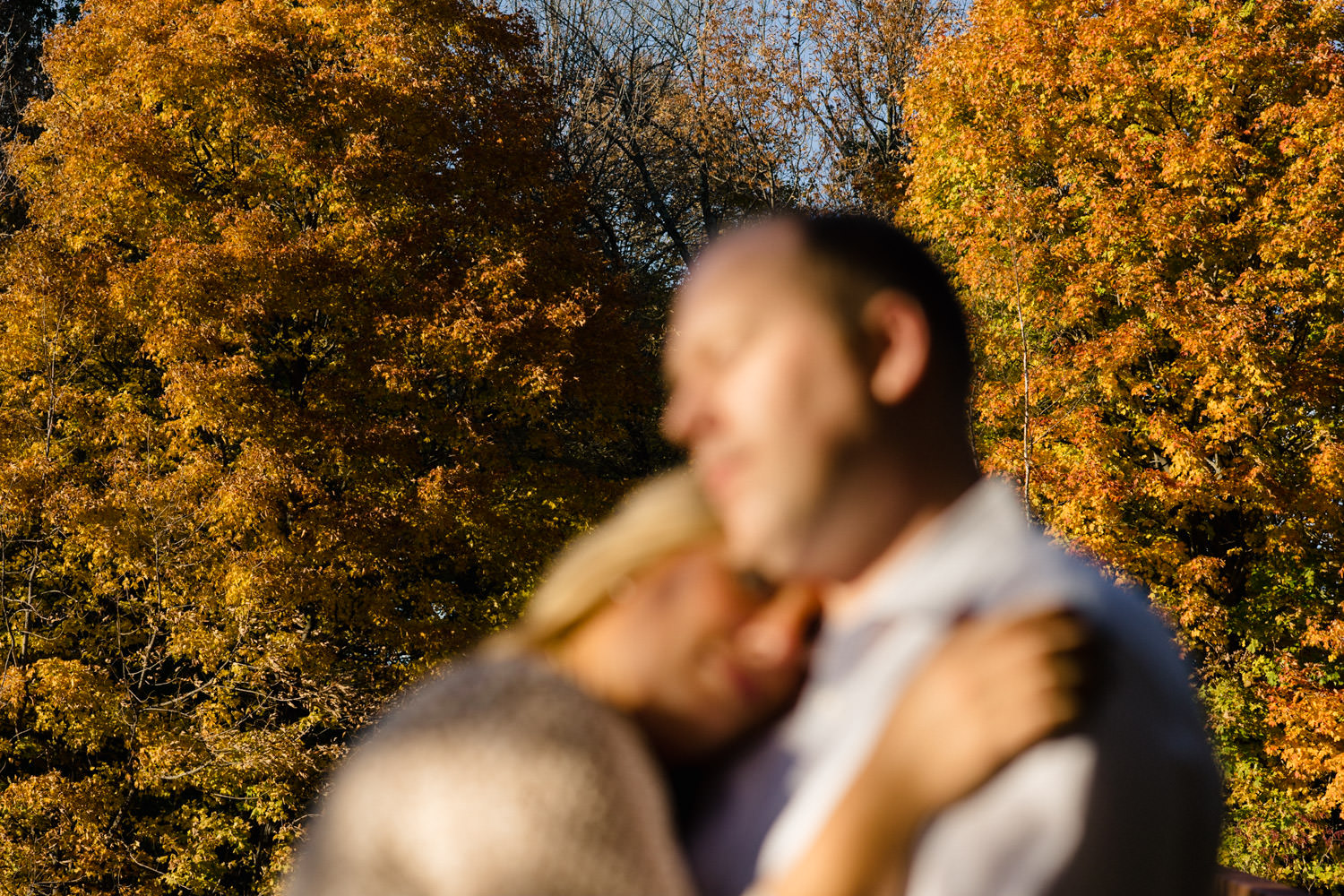 Vermont Fall Colors Engagement couple hugging photo