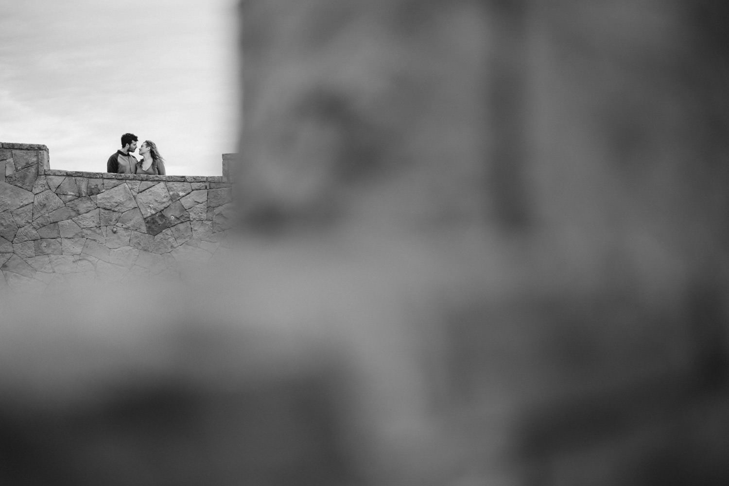 Downtown Denver Engagement Session bride and groom to be leaning in for a kiss photo