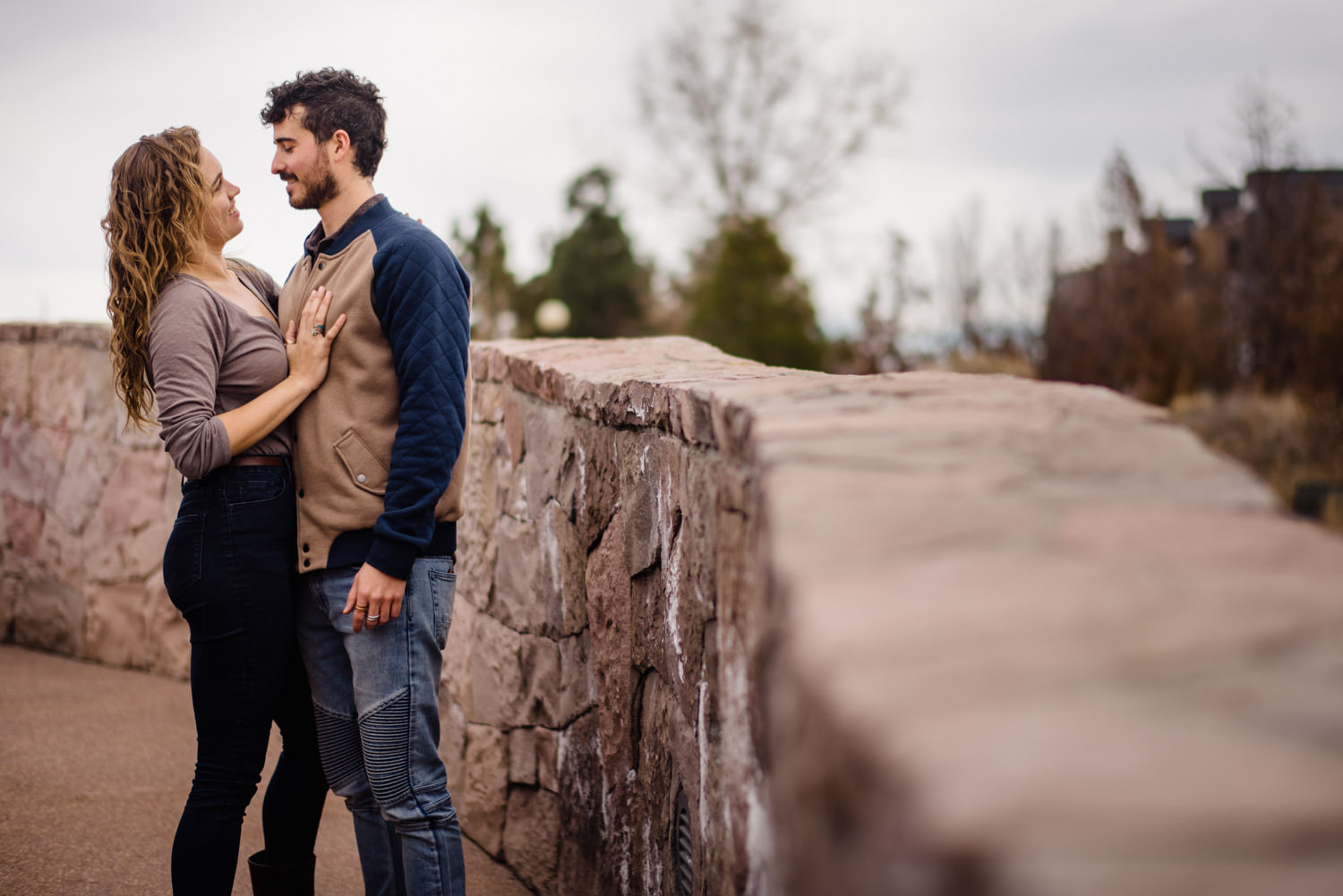 Downtown Denver Engagement Session woman with her hand on her fiancé's chest photo