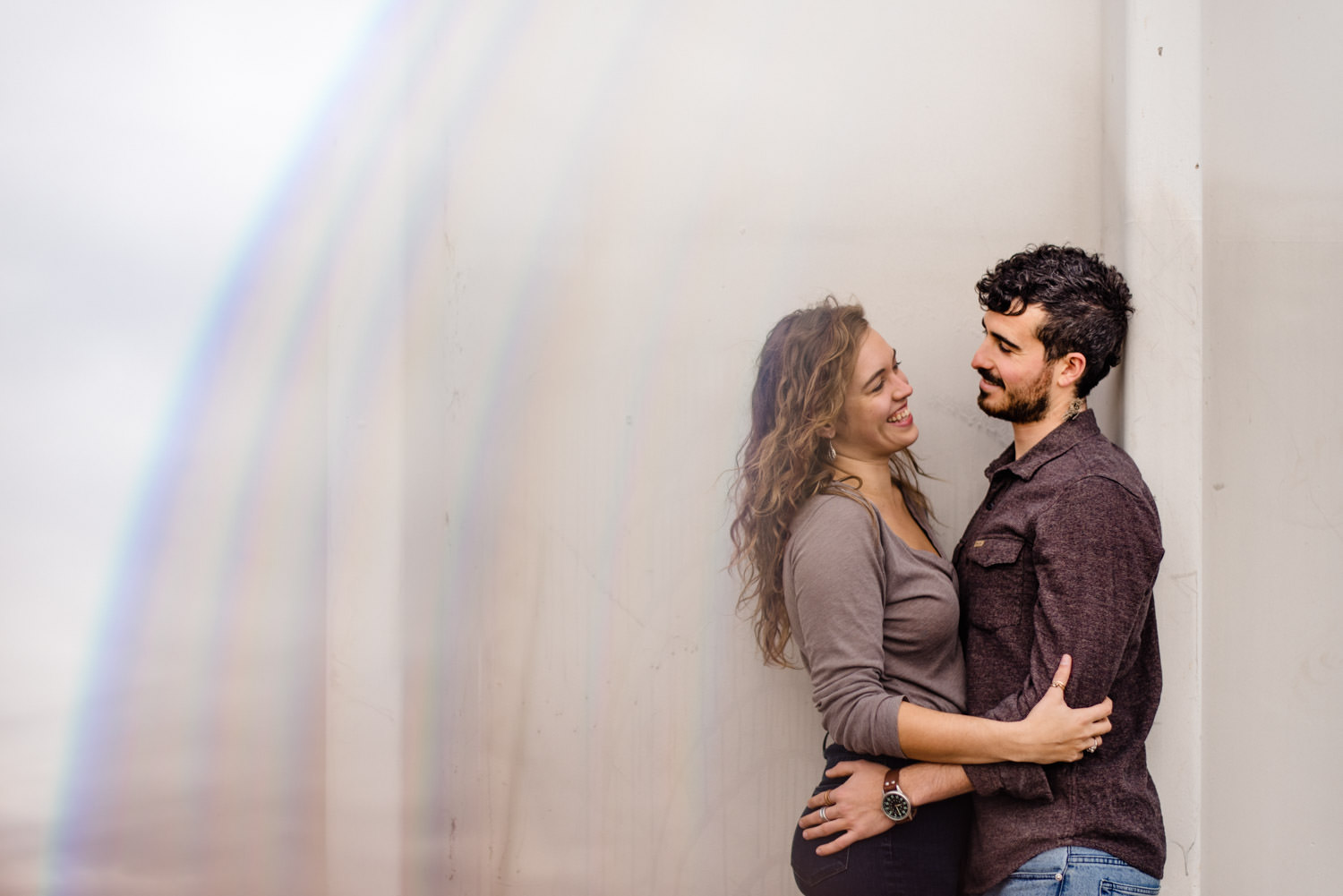 Downtown Denver Engagement Session couple laughing photo