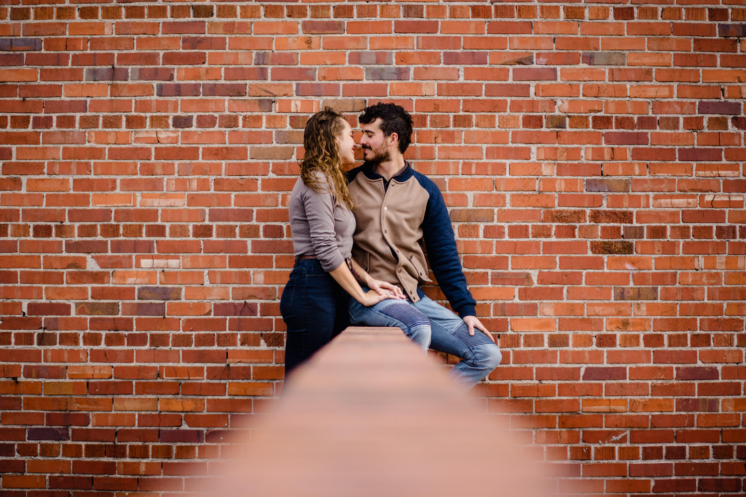 Downtown Denver Engagement Session couple leaning in for a kiss photo