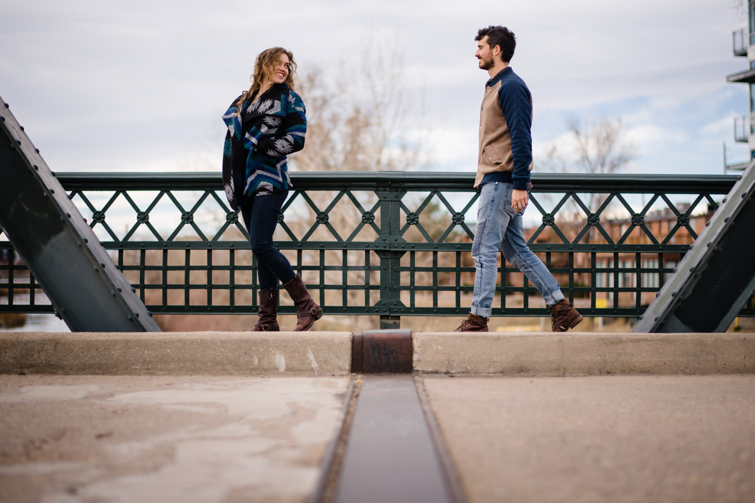 Downtown Denver Engagement Session woman laughing over her shoulder at fiancé photo