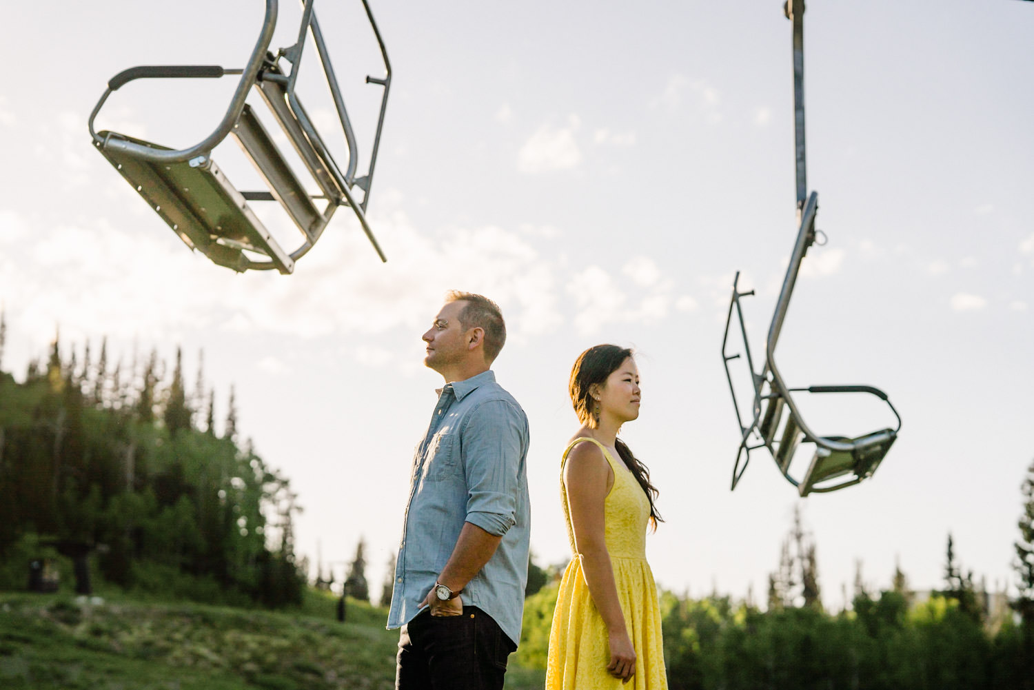 Solitude Mountain Resort Engagement engaged couple underneath the chair lift photo