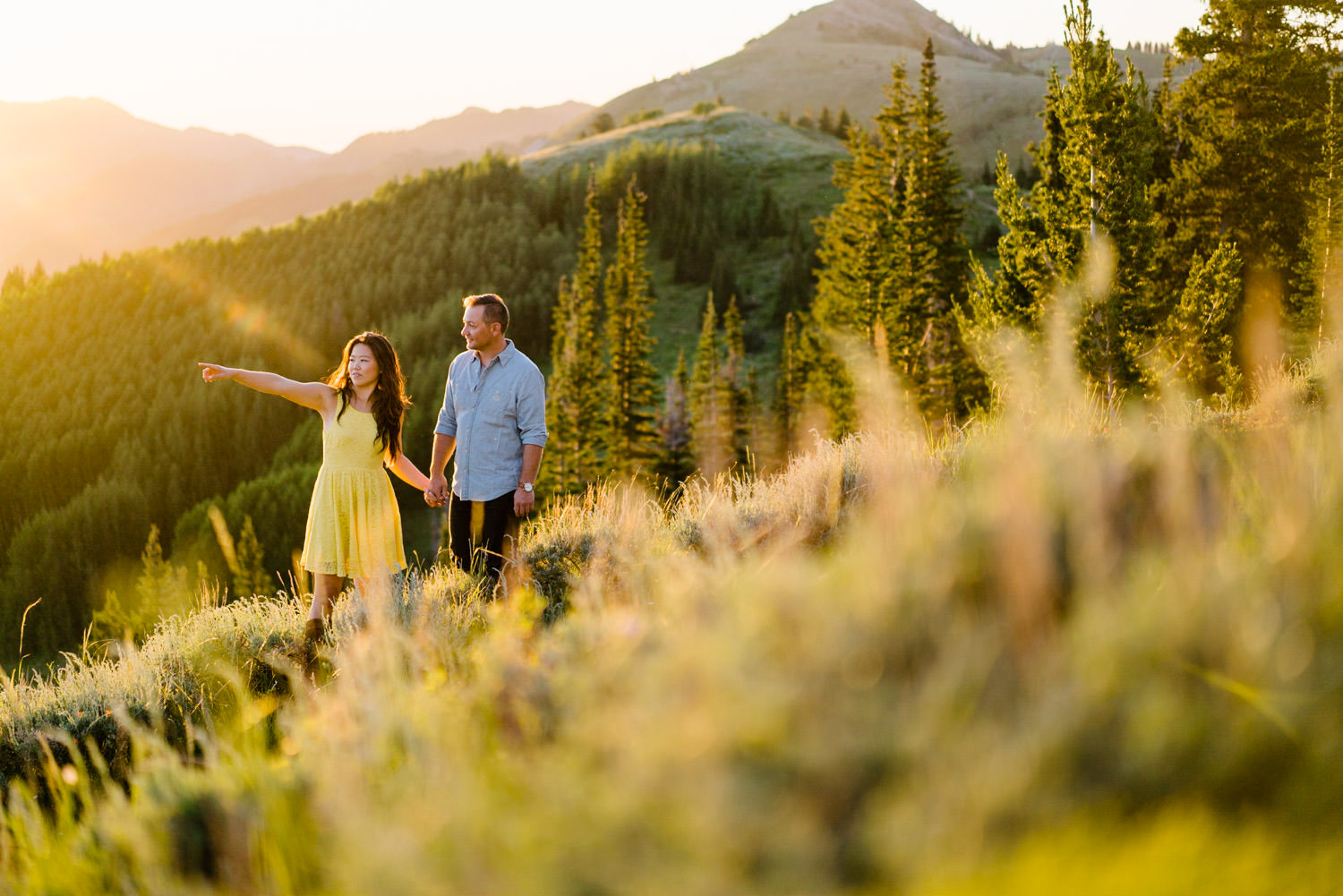 Solitude Mountain Resort Engagement couple walking through the mountains photo