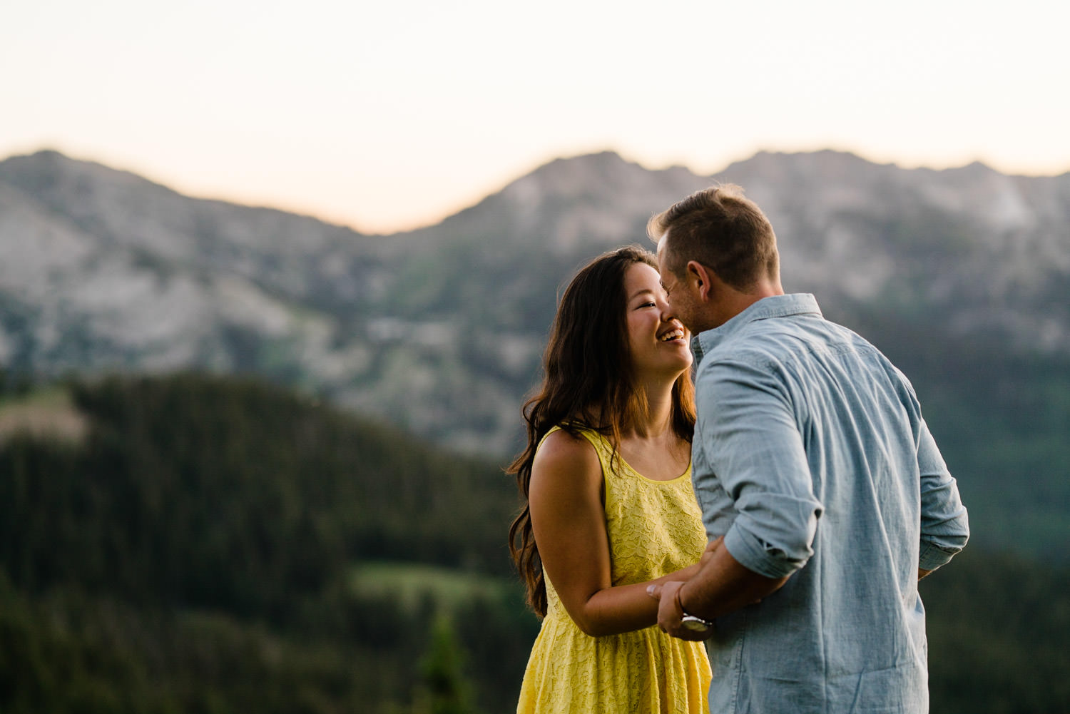 Solitude Mountain Resort Engagement woman smiling at fiancé photo