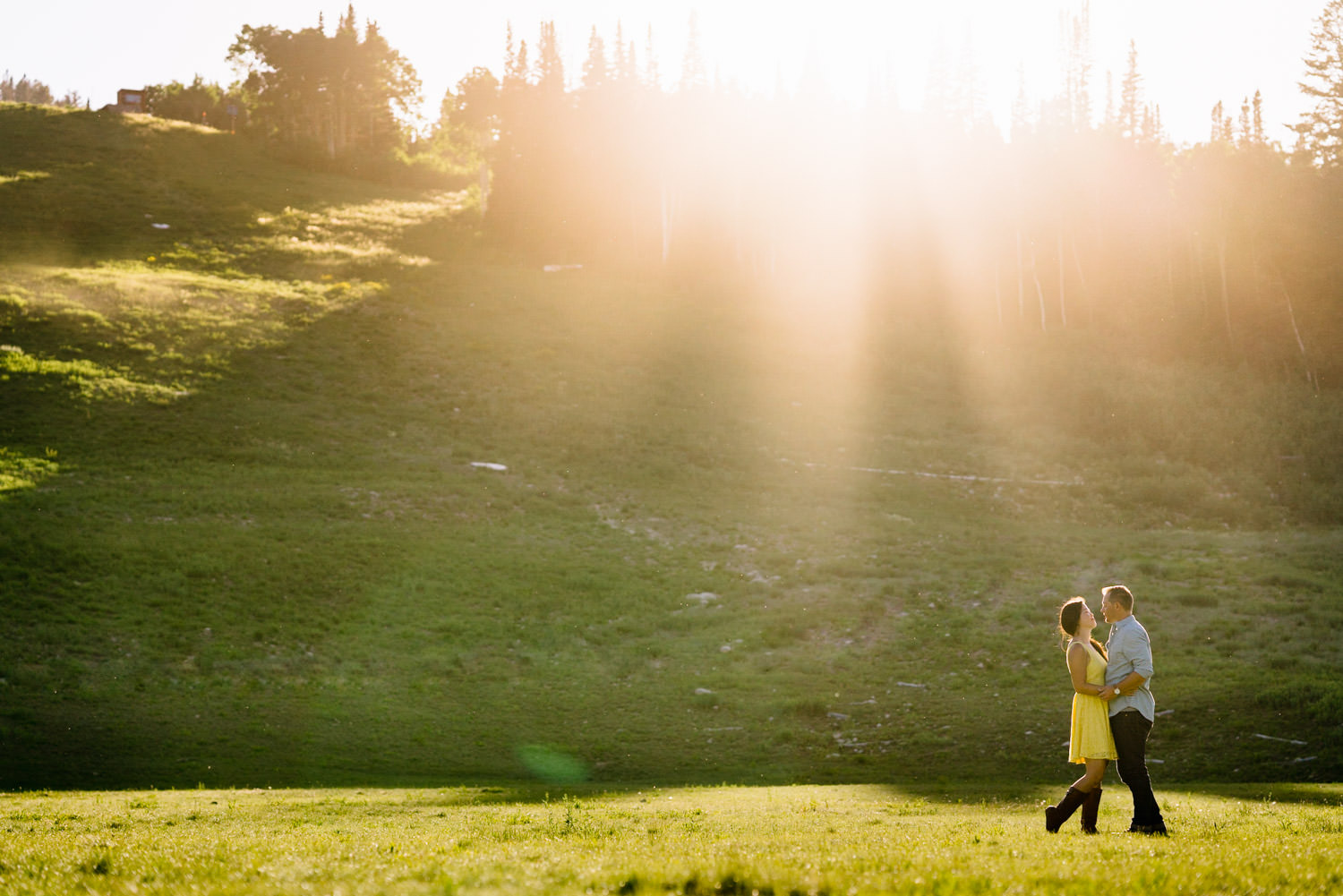 Solitude Mountain Resort Engagement couple dancing in a meadow photo