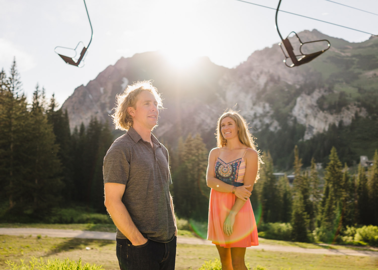 Alta Ski Area Engagement couple under a chairlift photo