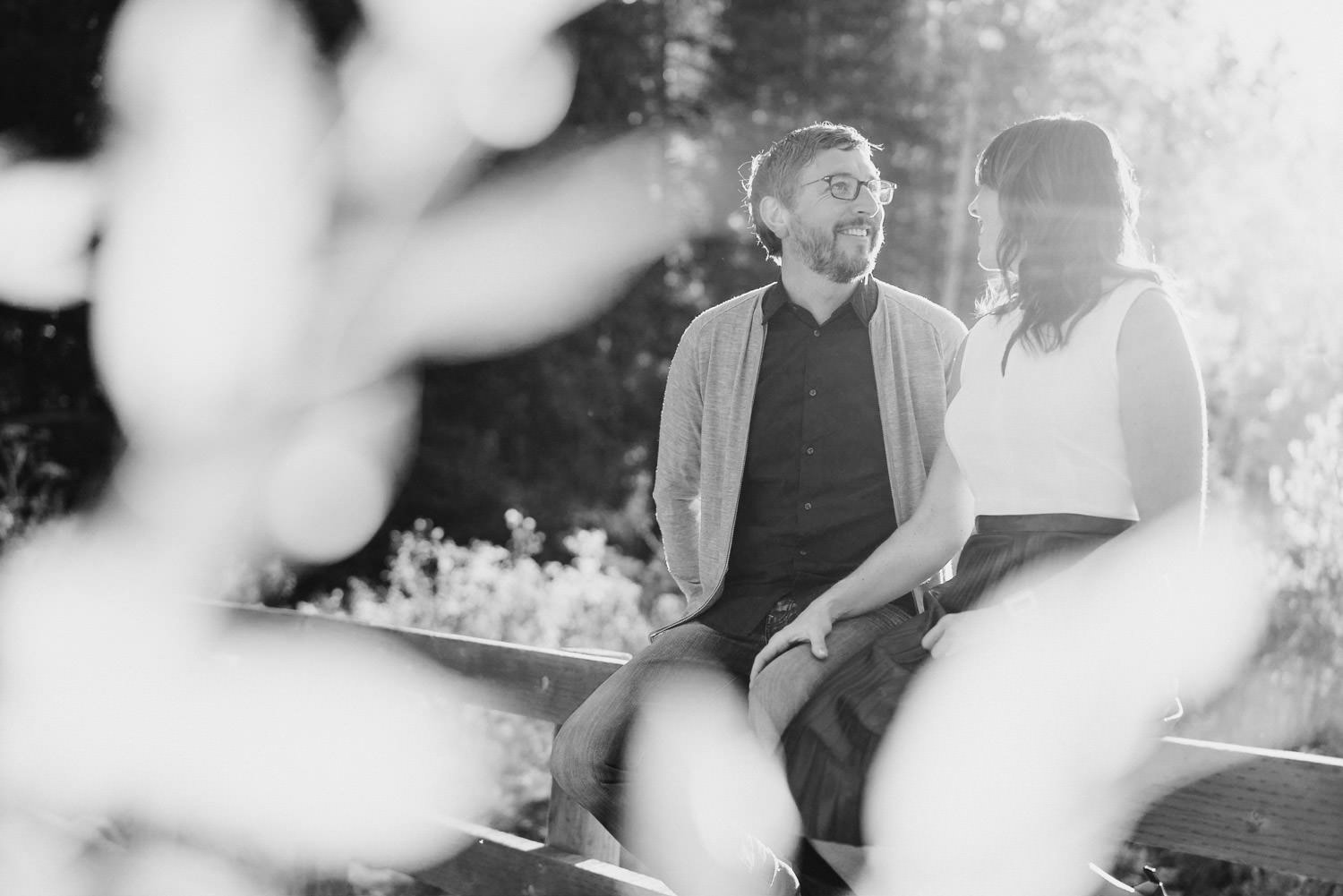 Millcreek Engagement couple smiling at each other photo