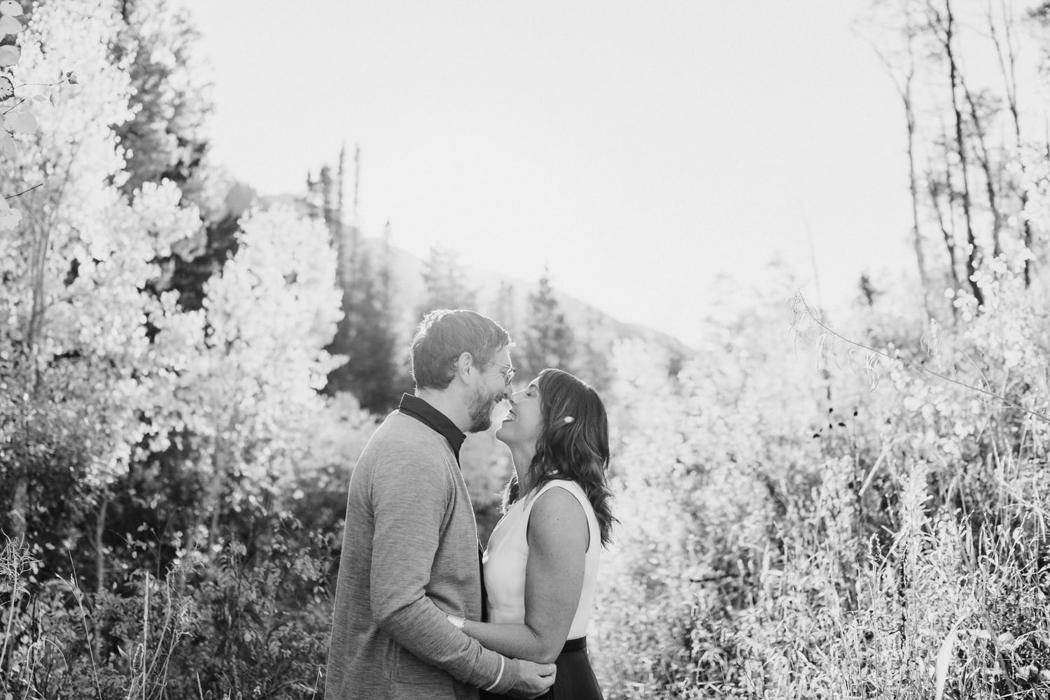 Millcreek Engagement couple smiling before a kiss photo