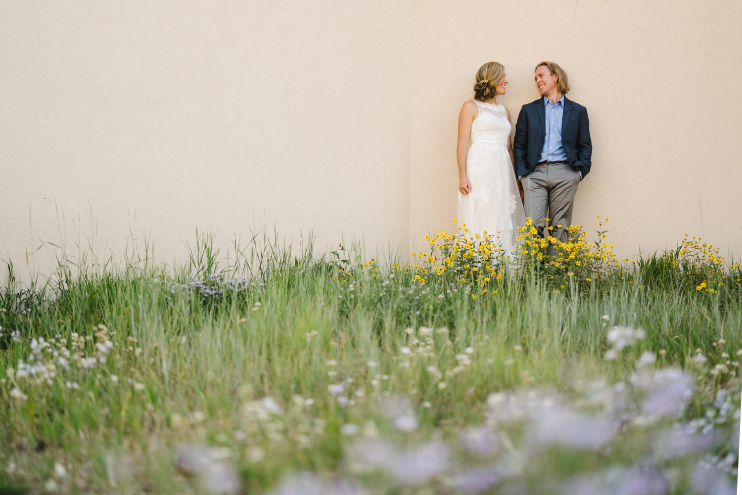 Alta Wedding bride and groom in wildflowers photo