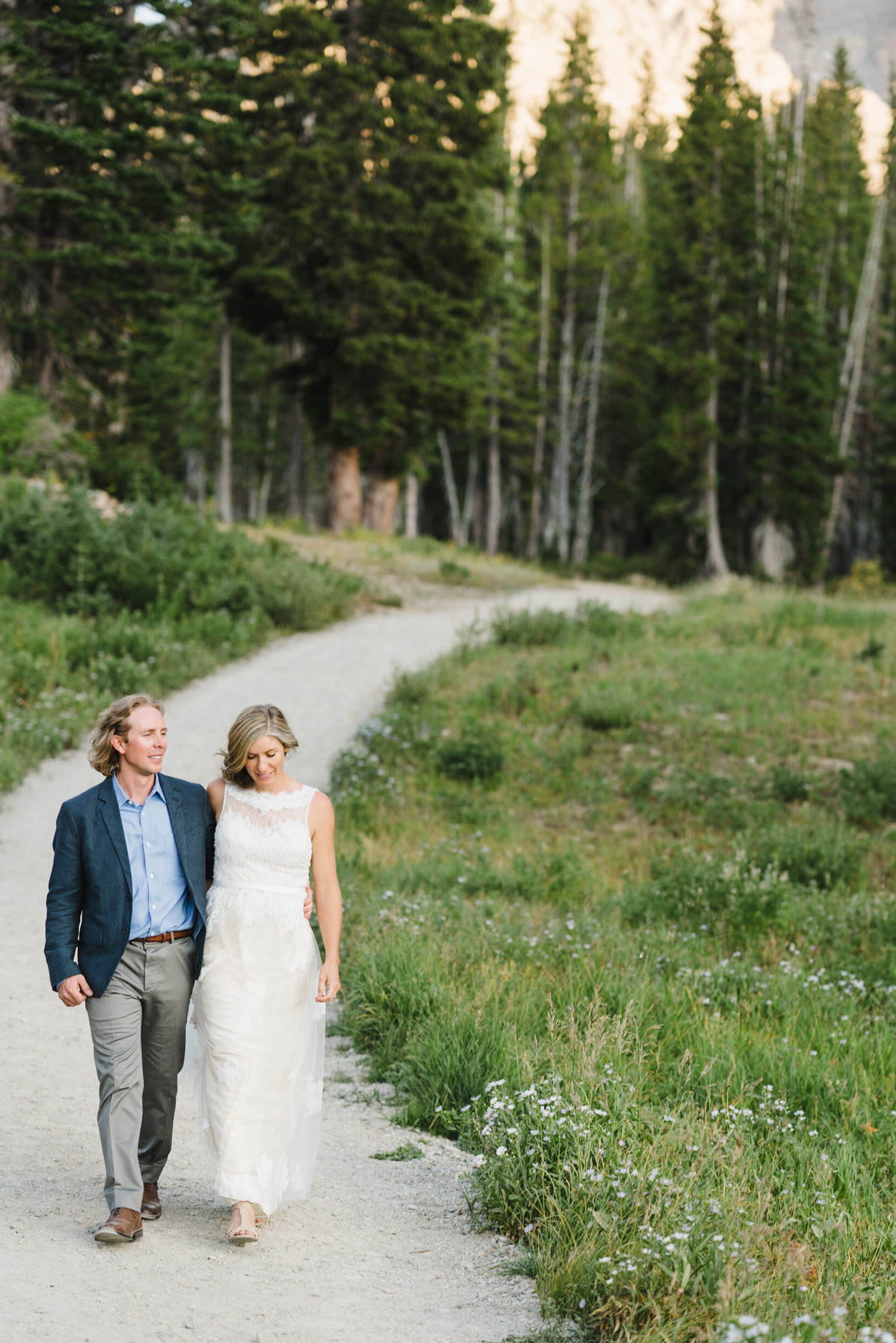 Alta Utah Wedding bride and groom holding hands photo