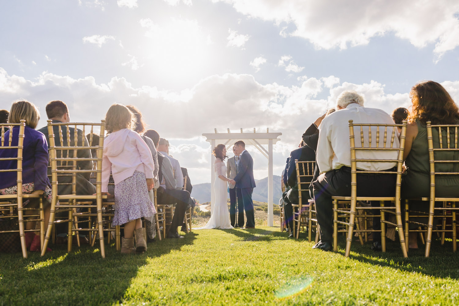 Tuhaye Golf Club Wedding in Park City bride and groom at the alter photo