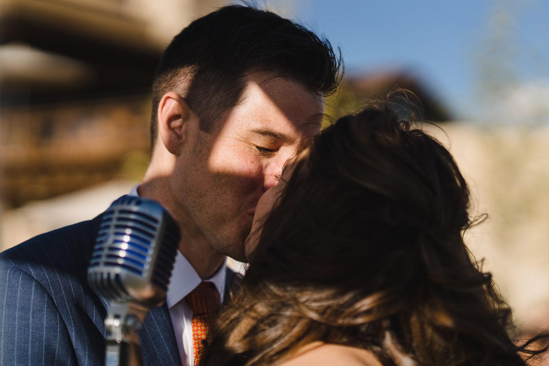 Tuhaye Golf Club Wedding bride and groom's first kiss photo