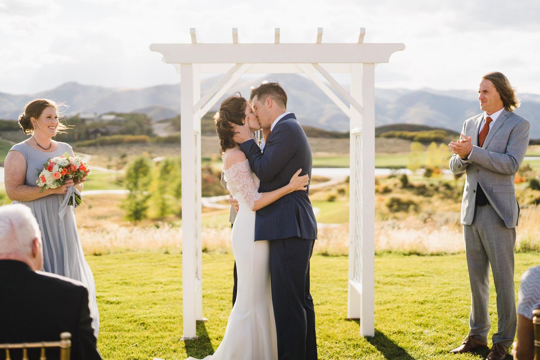 Tuhaye Golf Club Wedding newlyweds kissing at the alter photo