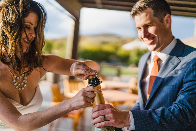 Tuhaye Golf Club Wedding bride and groom popping champagne photo