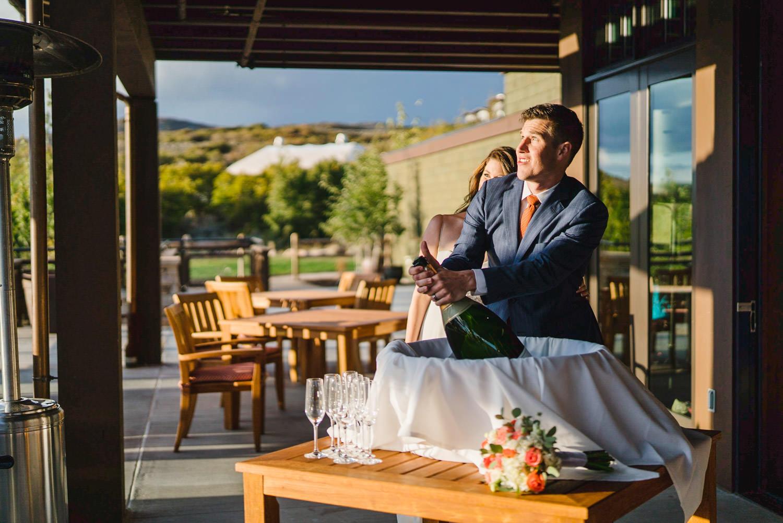 Tuhaye Golf Club Wedding groom popping champagne photo