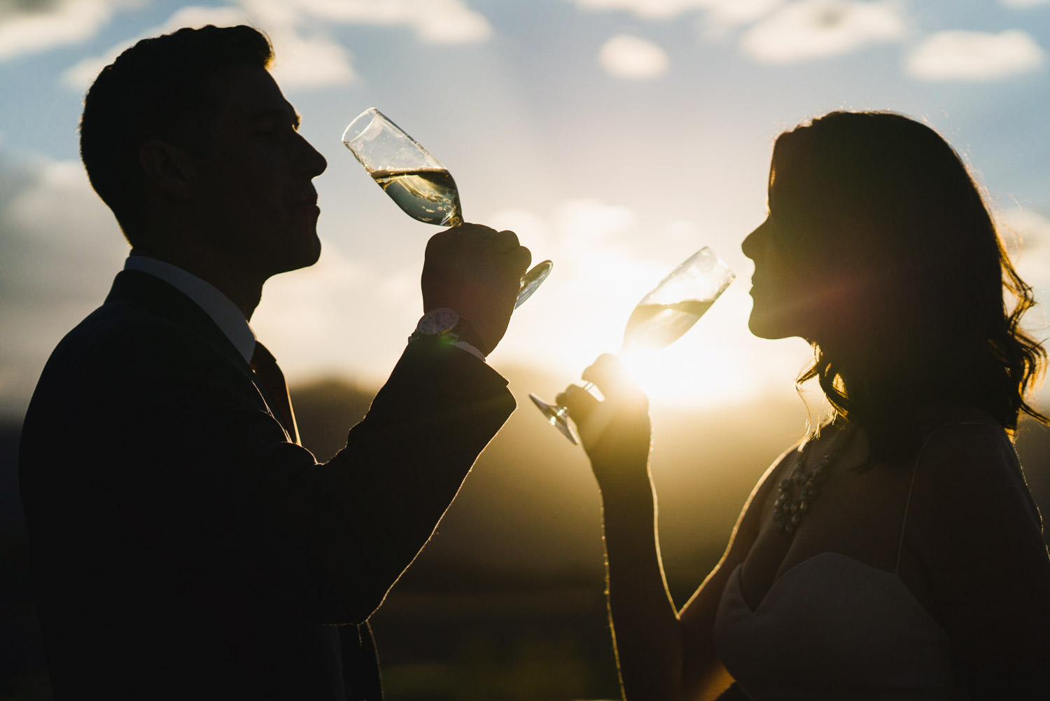 Tuhaye Golf Club Wedding bride and groom drinking champagne at sunset photo
