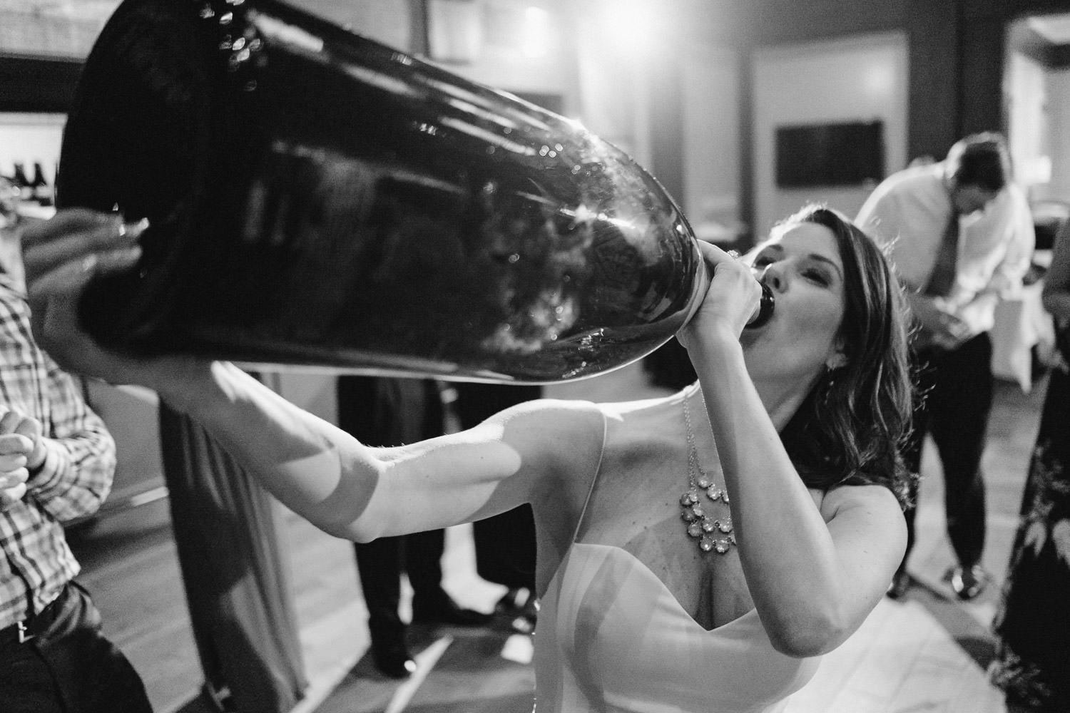 Tuhaye Golf Club Wedding bride drinking from giant champagne bottle photo