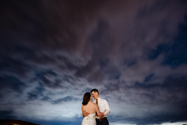 Tuhaye Golf Club Wedding bride and groom smiling at dusk photo