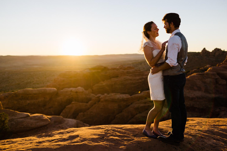Arches National Park Wedding newlyweds embracing photo