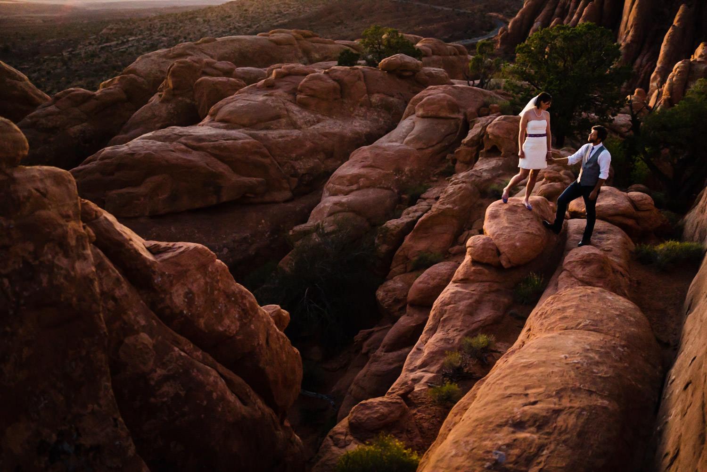 Arches National Park Wedding newlyweds holding hands photo
