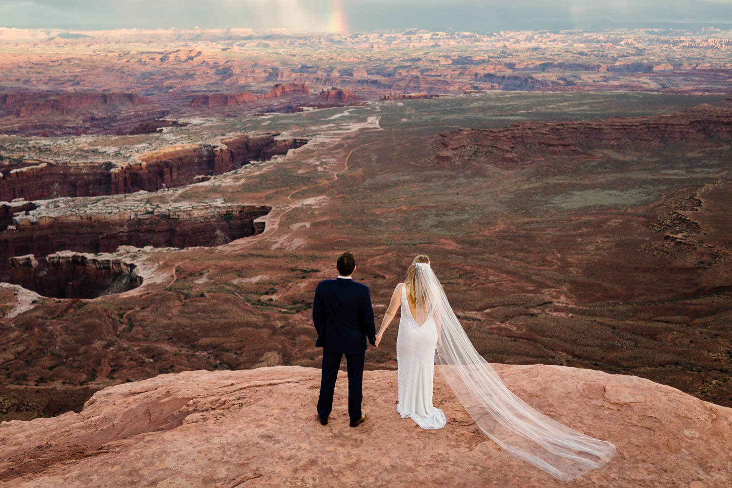 Canyonlands National Park Wedding bride and groom looking at the views photo