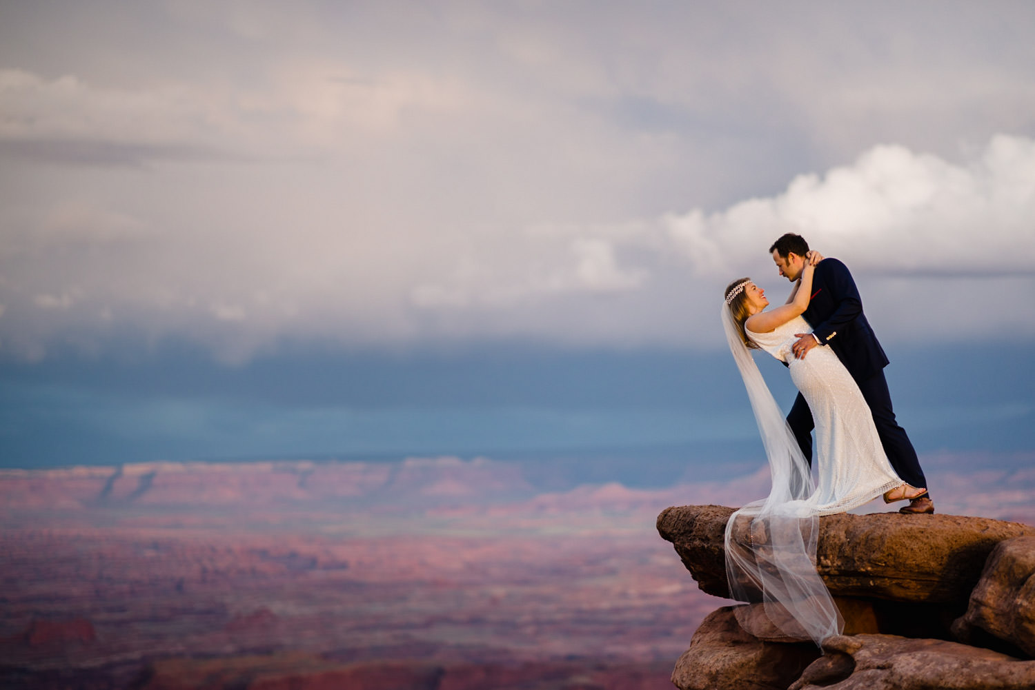 Canyonlands National Park Wedding groom dipping his bride photo