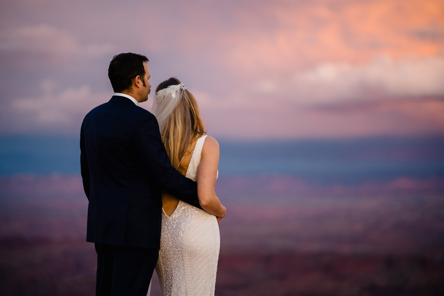 Canyonlands National Park Wedding bride and groom watching the sunset photo