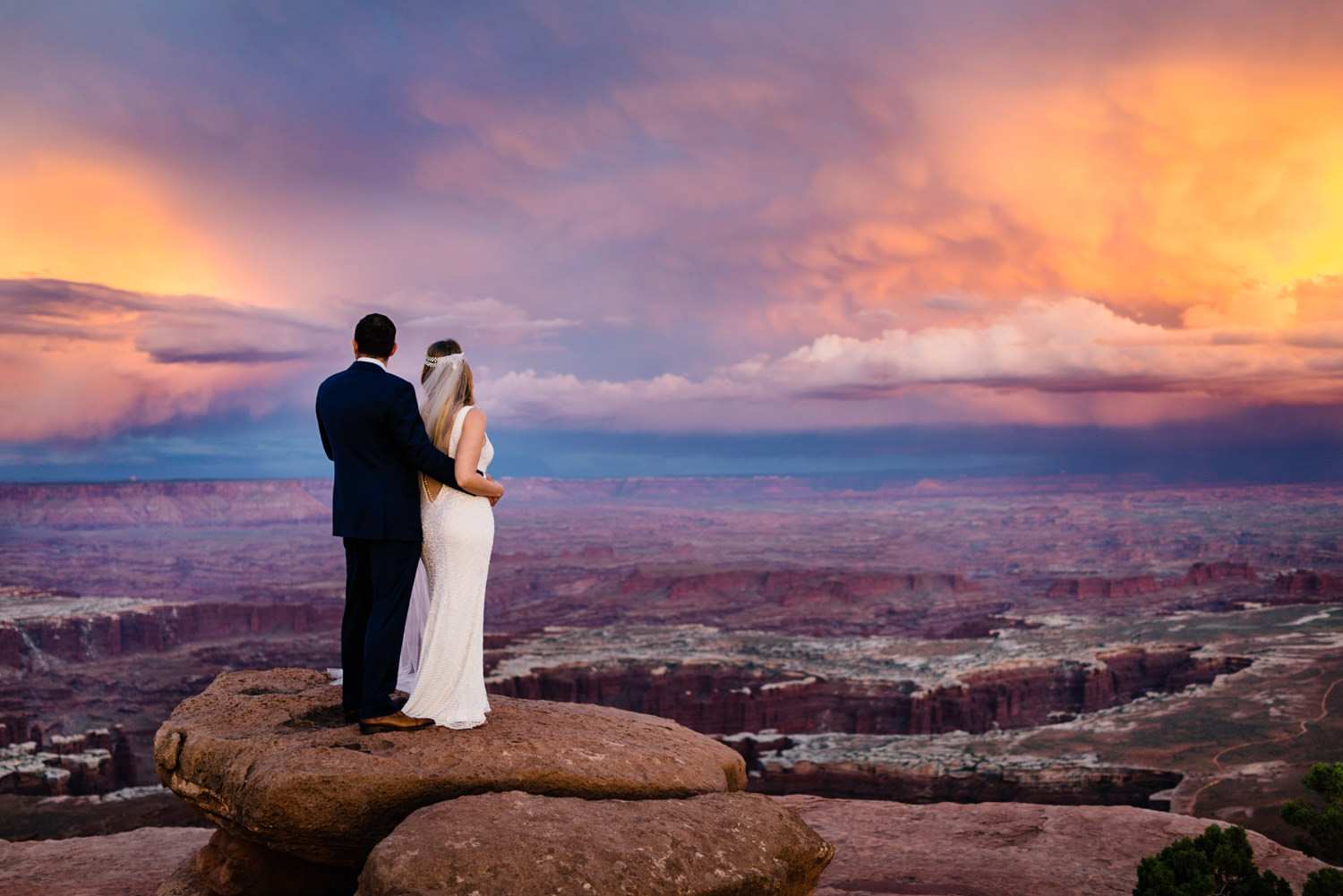 Canyonlands National Park Wedding newlyweds at sunset photo