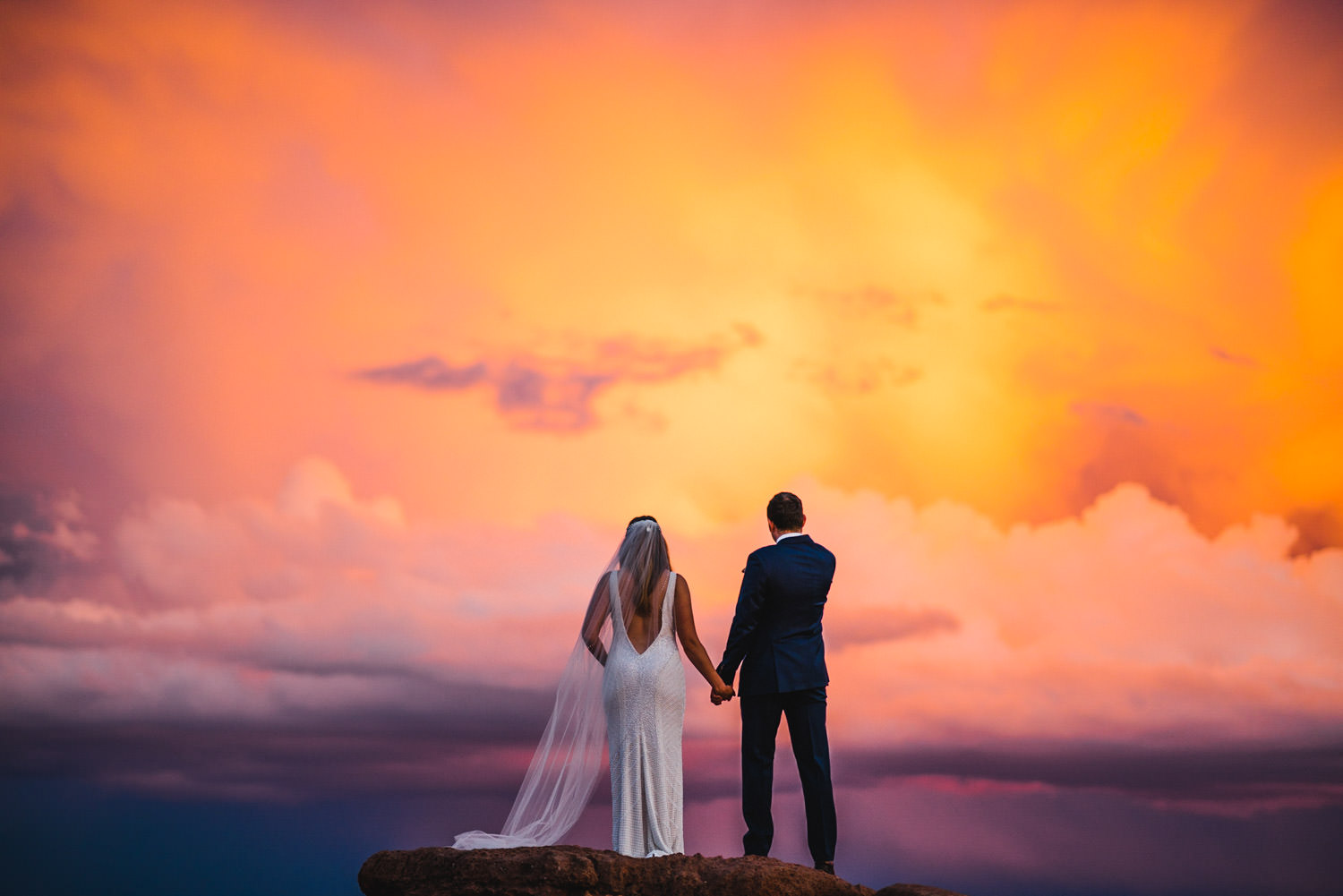 Canyonlands Wedding bride and groom watching the sunset photo