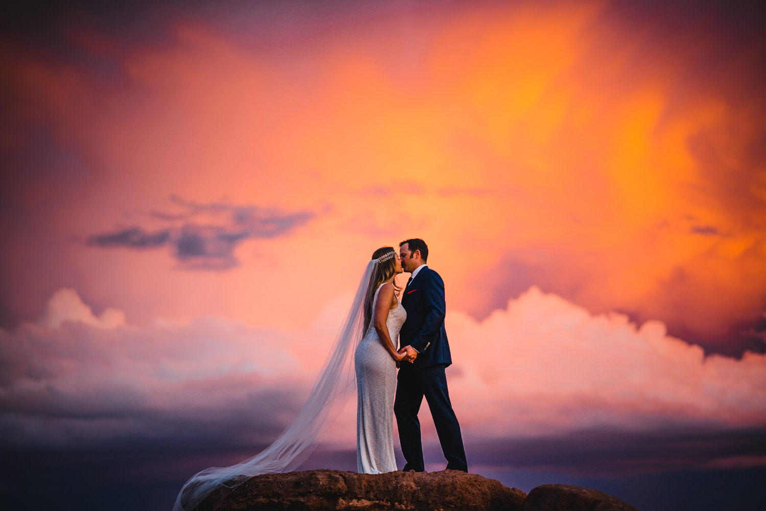 Canyonlands National Park Wedding bride and groom kissing at sunset photo