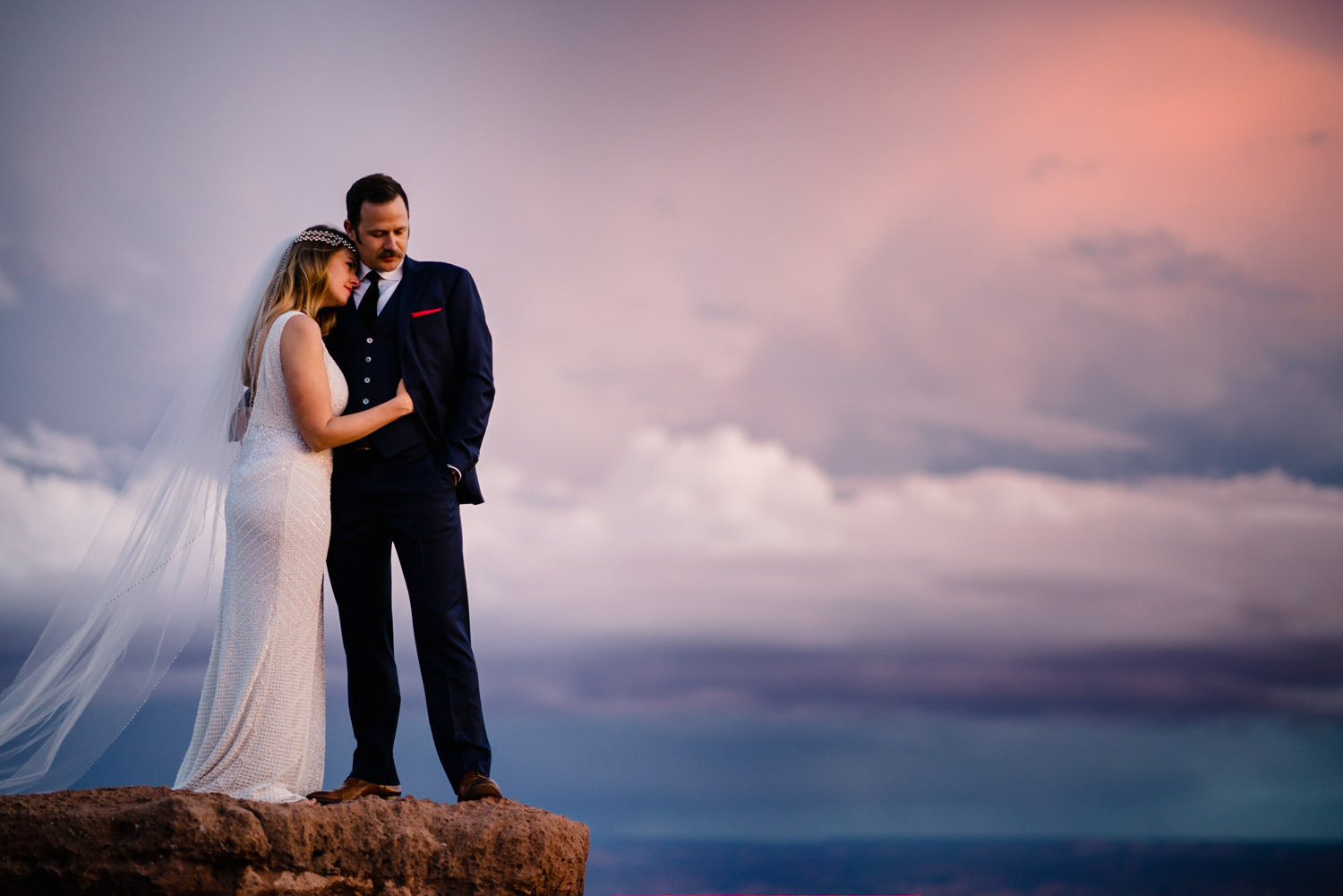 Canyonlands National Park Wedding bride hugging her husband photo